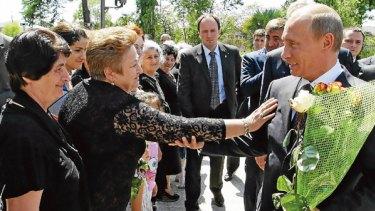 Russian Prime Minister Vladimir Putin meets locals in Abkhazia.
