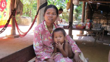 Cambodian maid Orn Eak, 28, with her  son Ho Bora, 5. Orn Eak was abused for almost two years by her Malaysian employer.