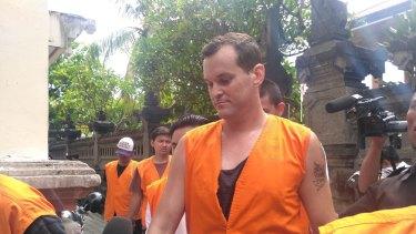 Thomas Harman arrives at Denpasar District Court.