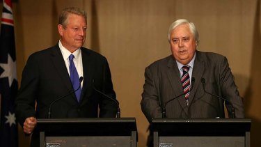 Clive Palmer, joined by former US vice-president Al Gore, has declared his vote to repeal the carbon tax will be contingent upon the government mandating that savings from lower energy costs are passed on to households.