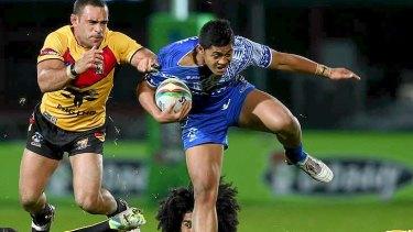 Anthony Milford of Samoa hurdles the Kumuls' defence.
