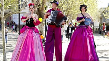 Over the top: Musicians on stilts entertain the crowds at Macquarie University.