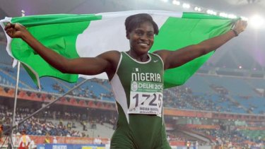 Osayemi Oludamola of Nigeria celebrates after the women's 100m final.