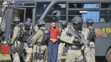 PREPARING: Elite police carry out a mock transfer of the Australians to the prison island where they will be killed.