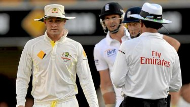 Nasty spat: James Anderson of England has words with Australia captain Michael Clarke.
