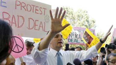 US Republican presidential candidate Senator Ted Cruz gestures as he engages in a  debate on the Iran nuclear deal with Code Pink peace activism group co-founder Medea Benjamin (left with small peace sign) across from the White House.