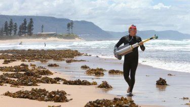 Pull factor: Dr Rob Brander mapping the currents of rips at Bulli beach.