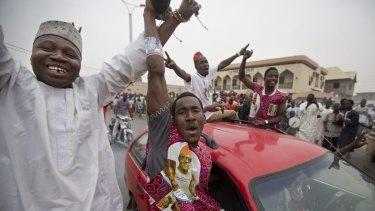 Muhammadu Buhari's supporters celebrate in Kano, Nigeria, on Tuesday.
