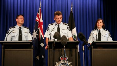 AFP Commissioner Andrew Colvin (centre), Deputy Commissioner Mike Phelan (left) and Deputy Commissioner Leanne Close (right).