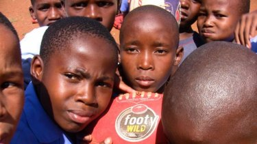Going global: Aussie rules touches down in Africa.