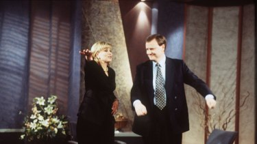 Former treasurer and current Nine chairman, Peter Costello, does the macarena with Kerri-Anne Kennerley in 1996.