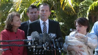 Policy dilemma ... Tony Abbott, pictured in 2010 announcing his planned changes to paid parental leave, is now under pressure to abandon the scheme.