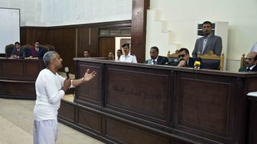 Mohamed Fahmy talks to the judge in May last year.