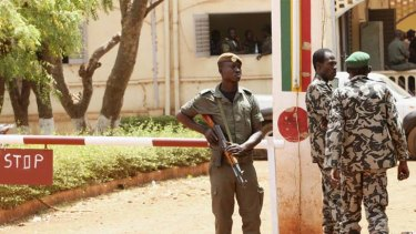 Mali soldiers stand their guard in Bamako.