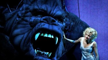 Hungry enough to swap her ukulele for a spoonful of soup: Esther Hannaford with friend in King Kong.