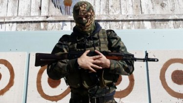 A Young pro-Russian rebel stands in front of shooting targets after training in the town of Donetsk, eastern Ukraine.