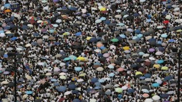 The annual July 1 rally, marking the day the territory returned to China, was tipped to draw the largest crowd since 2003, when half a million people turned out.