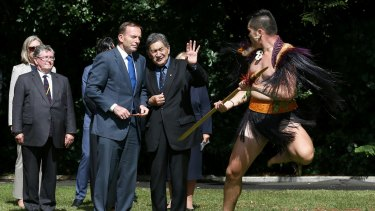 Tony Abbott is welcomed at Government House in Auckland on Friday.