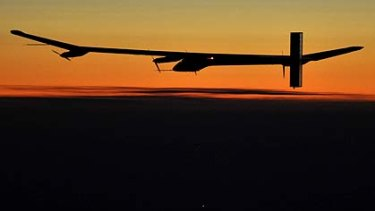 Solar Impulse's  pilot Andre Borschberg flies during sunset in the solar-powered HB-SIA prototype airplane during its first night flight attempt near Payerne airport.