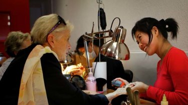 """It is so lovely to work for such nice ladies"" ... Thuy Dienh attends to the nails of a client at Mosman."