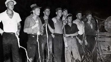 Back in 1939 ... firefighters battling a forest fire with improvished beaters.