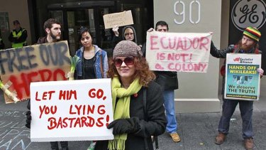 A group of Julian Assange supporters protesting outside the British Consulate in Melbourne.