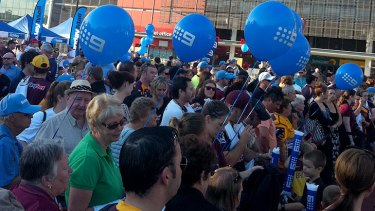 A crowd waits at Suncorp Stadium this morning for the unveiling of the Darren Lockyer statue.