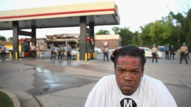 Marlon Carter, a rap musician from Kansas City, stayed in St Louis after his performance to join a protest over the killing of 18-year-old Michael Brown, who was shot by police on Saturday.
