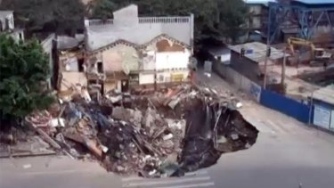 There she goes .... The sink hole swallows an entire building complex in Guangdong province, China.