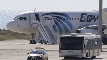 A bus carrying passengers from the hijacked EgyptAir aircraft at Larnaca Airport.