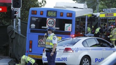 Rescue services at the scene in Neutral Bay where a cyclist was in a fatal collision with a bus.