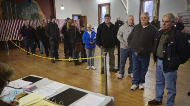 Voters wait in line to cast their ballots in the New Hampshire presidential primary.