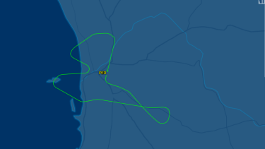 Qantas flight 566 turned back after and indicator light appear in the cockpit.