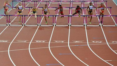 Just missed out ... Lolo Jones, right, came in fourth behind AUstralia's Sally Pearson, third left.