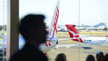 Battle of the skies: Alan Joyce says Virgin  is causing Qantas 'considerable pain' in the marketplace.