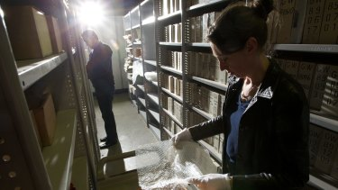 Fairfax librarian Ellen Fitzgerald and director of information services Chris Berry pack glass negatives at the Fairfax archives in Alexandria in 2012.