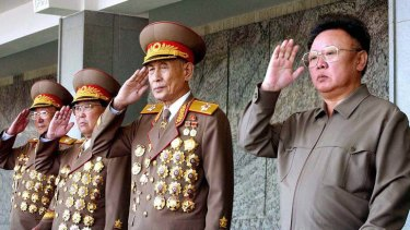 Dangerous times ... military leaders have reportedly been removed on the pretext of dishonouring the late Kim Jong-Il, right.