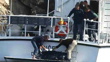 Croatian water police retrieve a body from a cove near Dubrovnik. It is not known yet whether the body is that of missing Melbourne backpacker Britt Lapthorne.