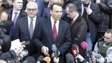 Unlikely partners: Poland's Foreign Minister Radoslaw Sikorski (R) and German counterpart Frank-Walter Steinmeier talk to media after brokering a peace deal in Ukraine.