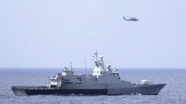 The Royal Malaysian Navy corvette KD Terengganu and a US Navy helicopter conduct a coordinated air and sea search for a missing Malaysian Airlines jet in the Gulf of Thailand.