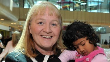 Moira Kelly with Krishna, who was conjoined to her twin Trishna before life-saving surgery.