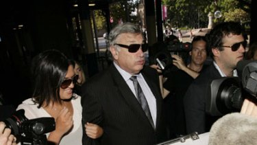 Once a national treasure...Marcus Einfeld was cheerful when he arrived at court, surrounded by  family and friends.