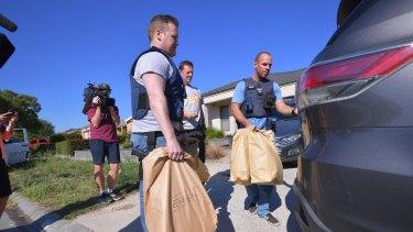 Police gathering evidence after Comanchero raids.