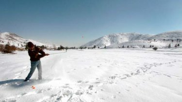 Testing conditions ... a golfer at the snow-covered Kabul Golf Club, which has had stints as a battlefield.