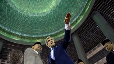 John Kerry, right, tours the Istiqlal Mosque in Jakarta with Grand Imam K.H. Ali Mustafa Yaqub.