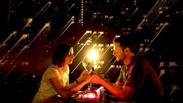Cherie Wilson and Andy Hill enjoy a candlelight dinner at Veludo restaurant in St Kilda. The restaurant turned the lights off as part of Earth Hour.