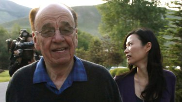 Rupert Murdoch, chairman and CEO of News Corporation, arrives with his wife Wendi in Sun Valley, Idaho in July.