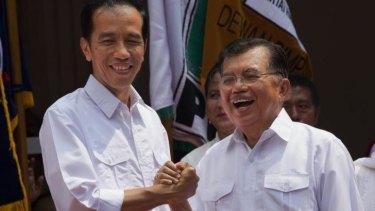 Joko Widodo, left,  and his running mate, Jusuf Kalla.
