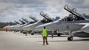 We're back: Australian F/A-18F Super Hornets prepare to depart to the Middle East.
