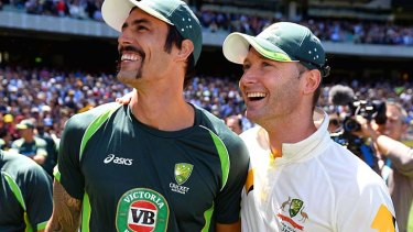 Winners are grinners: Mitchell Johnson and Michael Clarke after the MCG win.